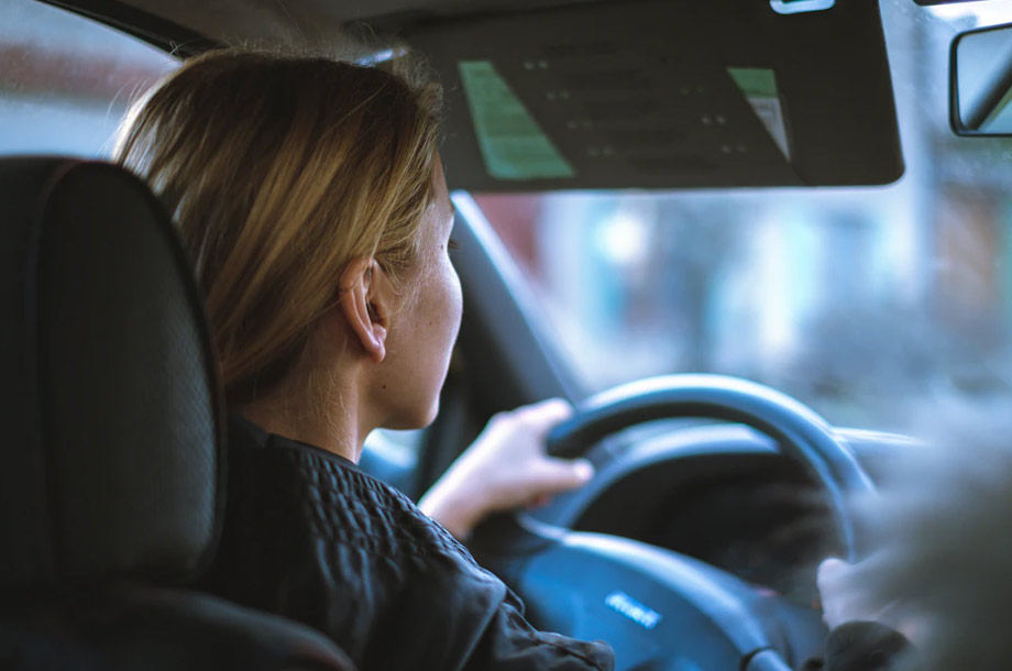 Inside view of woman driving | Auto Insurance